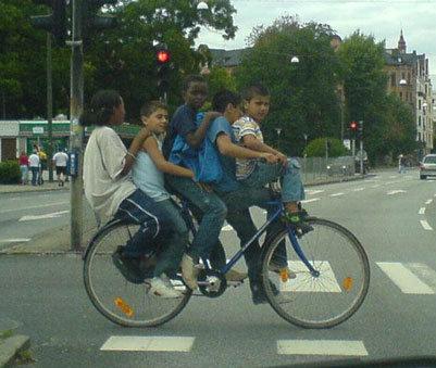 3rd wrld lol. how many peeps can u put on a bike.. (-___-)