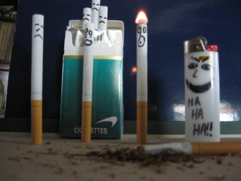 Cigarette Death. cigarettes kill humans, lighters kill cigarettes. its a part of the death chain I have many other artworks on also .. marlboro <3