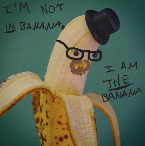 Hesienbanana. A banana with a small plastic hat with small plactic balls for eyes as well as drawn on glasses and facial hair.. Bananananana bananarking