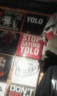 hot topic Tshirt display win. .. troll face... cancer... stop saying yolo
