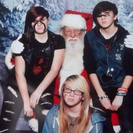 Looking thrilled. Santa's looking thrilled as always..