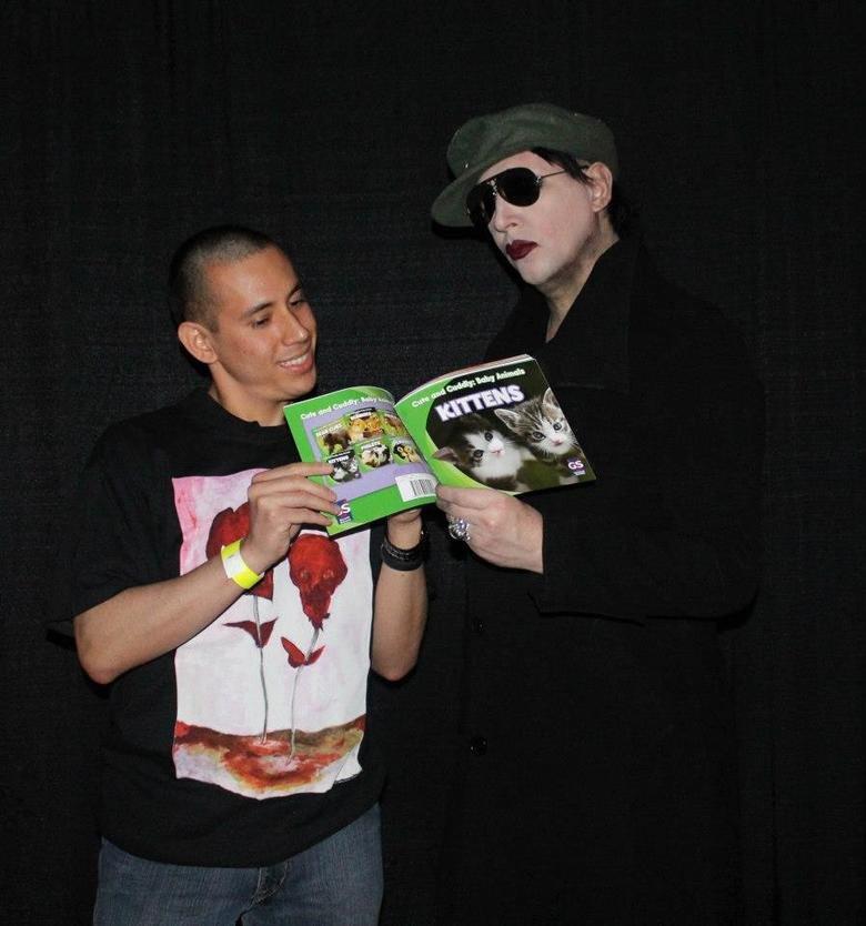 Marilyn Manson and kittens. I got to meet Marilyn Manson sooo......