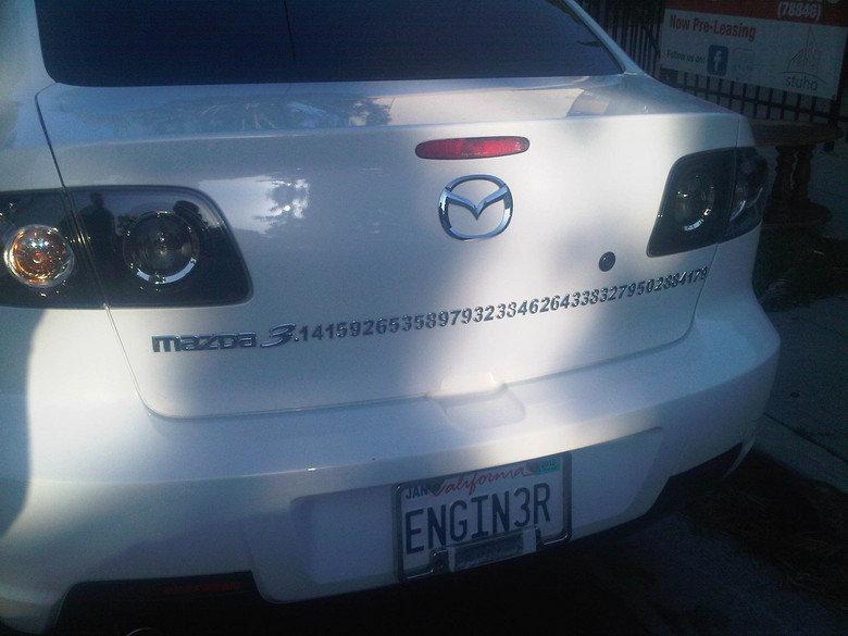 Mazda Pi. .. MFW His licence plate