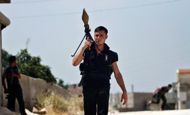 Ridiculously Photogenic Syrian Rebel. .. Gasmask guy forever...