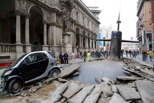 Submarine breaks through street. It's a publicity stunt.. How?
