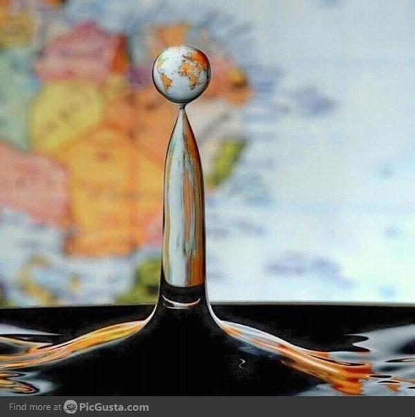 Water Drop. Behind a world map..