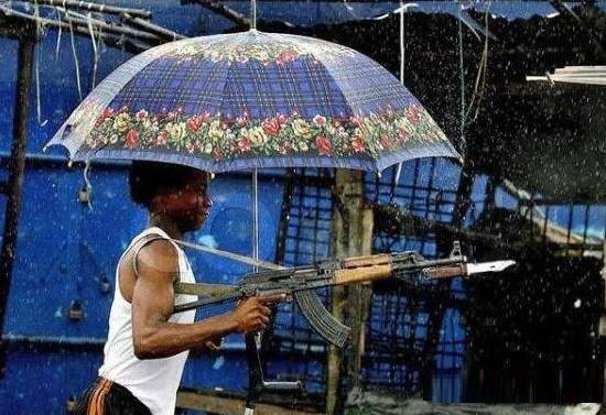 HOW TO SHOOT IN RAIN. .. Floral umbrella + AK47 = win?