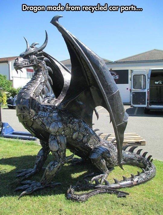 Metal dragon on the backyard. .