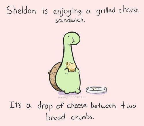 sheldon the tiny dino. . Sheldon enjoying a grilled cheese bread crumbs.,